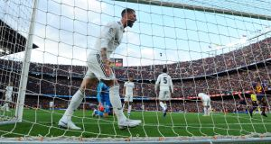 Sergio Ramos of Real Madrid reacts as Philippe Coutinho of Barcelona scores his side's first goal in a 5-1 thrashing. Photograph: Alex Caparros/Getty Images