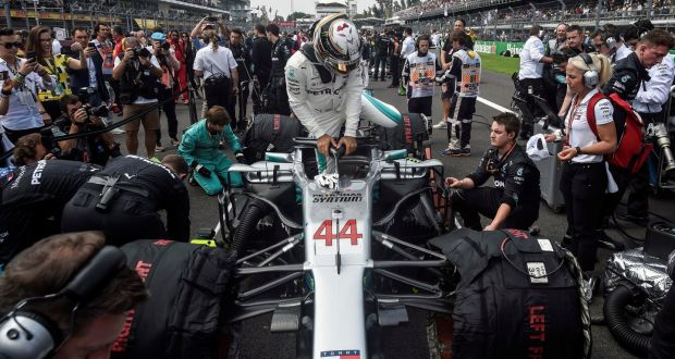 9590e0a3d Mercedes' British driver Lewis Hamilton gets on his car before the start.  Photograph: