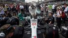 Mercedes' British driver Lewis Hamilton gets on his car before the start. Photograph: Alfredo Estrella/Reuters