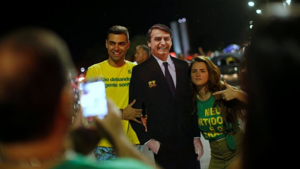Supporters of Jair Bolsonaro react after he wins the presidential race, in Brasilia. Photograph: Reuters/Adriano Machado
