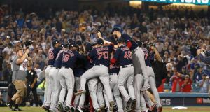 The Boston Red Sox celebrate their 5-1 win over the LA Dodgers in game five. Photograph:  Sean M. Haffey/Getty