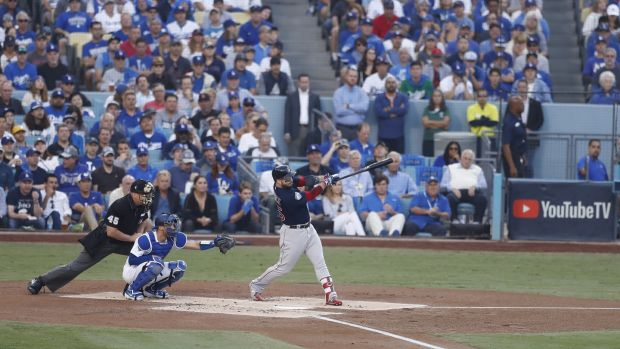 Steve Pearce hits a two-run home run in the top of the first inning of game five of the World Series. Photograph: Larry W Smith/EPA
