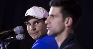 Rafael Nadal and Novak Djokovic, appearing at a 2015 press conference, are  due to play a lucrative exhibition tennis match in Saudi Arabia. Photograph: Nicolas Asfouri/AFP