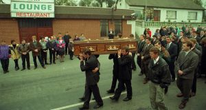 The funeral of Greysteel massacre victim Steven Mullan passes the Rising Sun bar where the atrocity took place. Photograph: Pacemaker