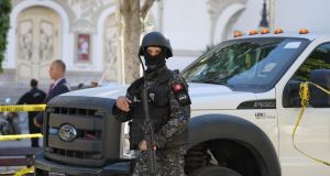 A member of the Tunisian security forces at the site of a suicide attack in the Tunisian capital Tunis. Photograph: Fethi Belaid/AFP/Getty Images