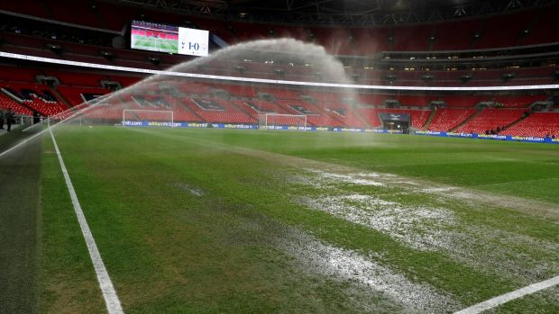 The Wembley surface is watered ahead of the Premier League game between Tottenham Hotspur and Manchester City at Wembley Stadium. Photograph: Paul Childs/Reuters