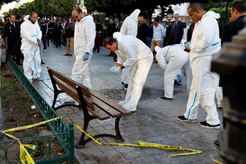 TUNIS ATTACK: Forensic experts work near the site of an explosion in the centre of the Tunisian capital Tunis. Photograph: Zoubeir Souissi/Reuters