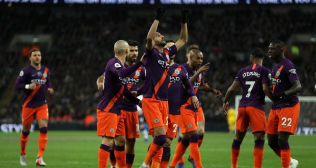 30c1d02ca Riyad Mahrez celebrates with his Manchester City team-mates after scoring a  goal during the