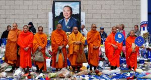 Bhuddhist monks stand in tribute after the Leicester's owner Thai businessman Vichai Srivaddhanaprabha, and four other people died when their helicopter crashed as it left the King Power stadium after the match on Saturday. Photo: Eddie Keogh/Reuters