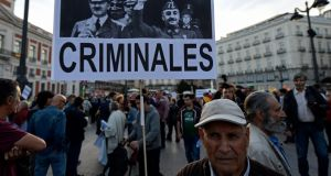 A  placard displaying pictures of Franco and  Hitler during a rally  in Madrid, held last week  against the proposal of moving Franco's remains to Madrid's Almudena Cathedral. Photograph: Oscar Del Pozo/AFP/Getty Images