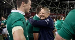 Ireland head coach Joe Schmidt celebrates winning the Six Nations with CJ Stander and Jonathan Sexton. Photo: Dan Sheridan/Inpho