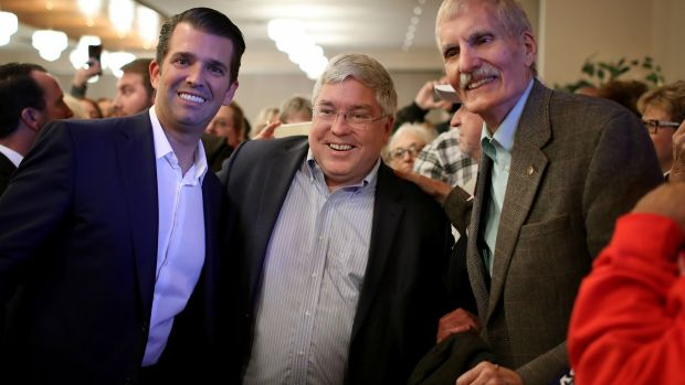 Donald Trump jnr greets West Virginia voters with Republican US Senate candidate Patrick Morrisey (centre) speaking at a campaign even. Photograph: Win McNamee/Getty Images