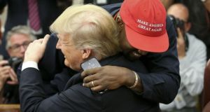 Kanye West hugs US president Donald Trump in the White House Photograph: Oliver Contreras