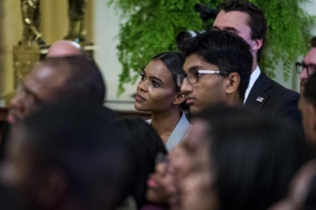 Candace Owens (centre) looks on as US president Donald Trump addresses young black conservative leaders from across the country as part of the 2018 Young Black Leadership Summit at the White House on October 26th in Washington, DC. Photograph: Pete Marovich/Getty