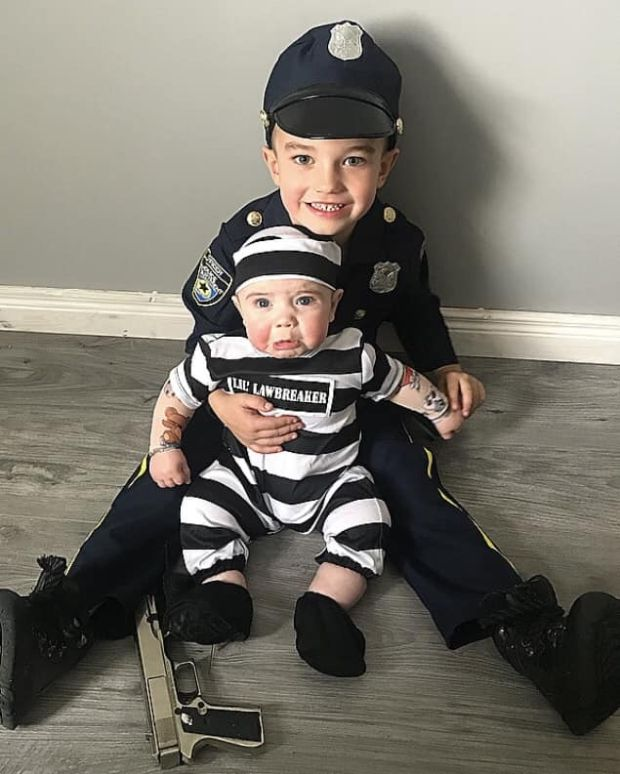 Kadyn (5 months) getting arrested by big brother Masyn (4) Photograph: Nicole Kee