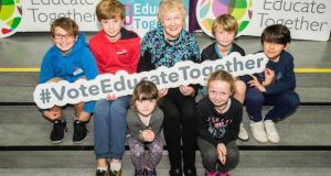 Prof Áine Hyland, one of the founding parents of the Dalkey School Project, with David Rankin (10), Dylan O'Broin (11), Emily Roarty (5), Sophie Roarty (8), Matt O'Broin (7) and Oliver Donohue (9) at Educate Together's 40th anniversary event earlier this year. Photograph: Brendan Lyon/ImageBureau