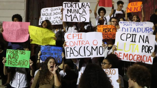 Hundreds of Brazilians, mostly students, demonstrated in several cities in the country against the elected president, the far-right Jair Bolsonaro, and demanded that he respect democracy during his term. Photograph: Marcelo Sayao/EPA