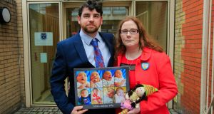 John and Louise Wills with photos of their baby daughter Eibhlín Wills who died aged  12 days old from the common cold sore virus. Photograph: Gareth Chaney/Collins