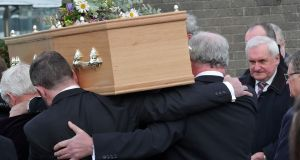 Former taoiseach, Bertie Ahern looks on as the remains of his former advisor  Paddy Duffy are carried into  Our Lady Queen of Heaven Church, Dublin Airport.  Photograph:  Collins