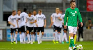 Ireland's Ryan Manning dejected after his side conceded an early goal to Germany during the recent European under-21 Championship qualifier. Photo: Oisin Keniry/Inpho