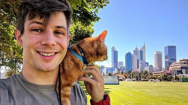 Oisín Tracey posts pics of him out and about around Perth with his cat Oliver and other animals, to promote pet-friendly venues across the city. Photograph: @pawsomedoctor/Instagram