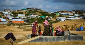 Rohingya refugees collecting water at the Kutupalong refugee camp in Ukhia, Bangladesh in August 2018. Photograph: Chandan Khanna/AFP/Getty Images