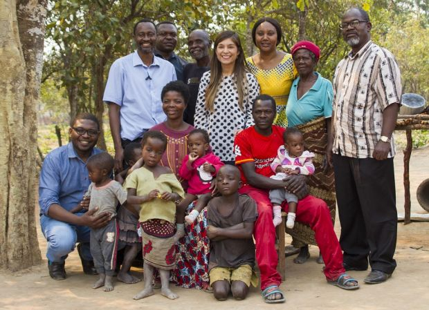 The family of Moses and Lydia Mwape, with doctors involved in the operation to separate twins Bupe and Mapalo. Taken in the village of Chabatama, northern Zambia. Photograph: Blaine Rennicks