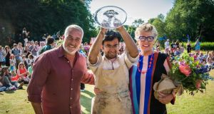 Rahul Mandal (centre) is crowned champion by judges Paul Hollywood and Prue Leith (right) Photograph: C4/Love Productions/Mark Bourdillon/PA