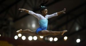 Simone Biles competes in the women's all-around final of the 2018 FIG Artistic Gymnastics Championships at the Aspire Dome  in Doha. The American gymnast became the first woman to win four all-around world championships. Photograph: Karim Jaafar/AFP/Getty Images