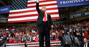 President Donald Trump  during a rally in Estero, Florida, where he was  campaigning for  Republican governor  Rick Scott, who is challenging incumbent Democratic senator  Bill Nelson for a seat in the Senate. Photograph: AP Photo/Susan Walsh