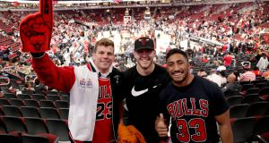 Jordi Murphy, Will Addison and Bundee Aki at Tuesday night's Chicago Bulls v Denver Nuggets NBA game  at  the United Center in  Chicago. Photograph: Dan Sheridan/Inpho