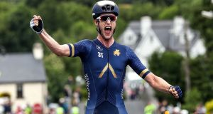 Conor Dunne celebrates winning the Cycling Ireland Road Racing National Championships in Sligo last July. Photograph: Bryan Keane/Inpho