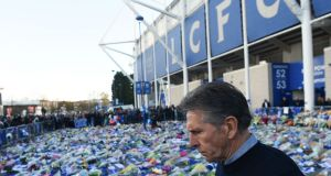 Leicester City manager Claude Puel looking at the floral tributes  to the five victims of the helicopter crash which killed Leicester City's chairman Vichai Srivaddhanaprabha. Photograph: Paul Ellis/AFP/Getty Images
