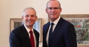 Tánaiste and Foreign Affairs Simon Coveney (right) greets   UK minister for the cabinet office David Lidington. Photograph via Twitter
