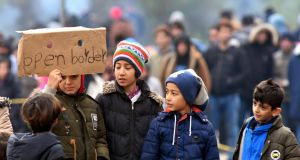 Migrant children protest in the vicinity of Maljevac border crossing with neighbouring Croatia, near the northern Bosnian town of Velika Kladusa, on October 24th.  Photograph: Elvis Barukcic/AFP/Getty Images