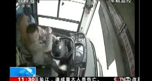 A bus driver strikes a passenger moments before the bus plunged off a bridge into the Yangtze River in Wanzhou in southwestern China's Chongqing Municipality last Sunday. Photograph: CCTV via AP Video