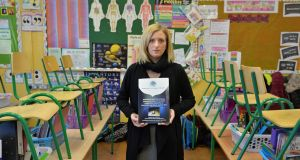 "Angela Dunne, teaching principal at Loughmore national school, Co Tipperary, holding a copy of the submission from the National Principals Forum highlighting the ""unsustainable"" pressure on principals. Photograph: Alan Betson"