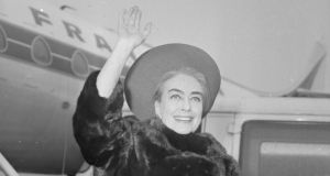 'The Montague was set on its hook again, until Cecil heard Joan Crawford was due to fly in to Dublin Airport.' Above,   Crawford  waving to photographers at London airport in April 1966. (Photo by Dove/Express/Getty Images)