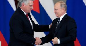 Cuba's  Miguel Diaz-Canel shakes hands with Russian president Vladimir Putin  in the Kremlin during his state visit. Photograph: Sergei Chirikov