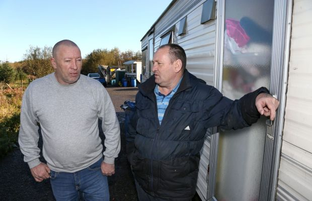 Photograph for Rosita Boland story - Ballinasloe travellers. Martin Cawley (left) with his cousin Jim Ward, at the site where Martin lives near Ballinasloe. Photograph: Joe O'Shaughnessy. 1/11/2018