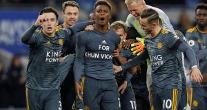 Leicester City's Demarai Gray celebrates scoring their first goal with team-mates wearing a shirt in remembrance of Vichai Srivaddhanaprabha, the chairman of the club who dies in last weekend's helicopter crash. Photograph:  Darren Staples/Reuters