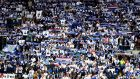 Leicester City fans commemorate Vichai Srivaddhanaprabha by holding up scarfs and signs during the Premier League match between Cardiff City and Leicester City at Cardiff City Stadium. Photograph: Michael Steele/Getty Images