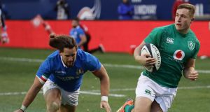 Ireland's Jordan Larmour gets past Italy's Michele Campagnaro  to run in his third try during the match at Soldier Field. Photograph: Jonathan Daniel/Getty Images