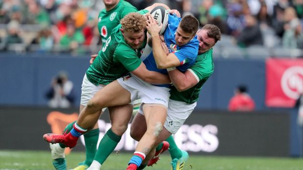 Italy's Luca Sperandio is tackled by Finlay Bealham and Dave Kilcoyne of Ireland during the match at Soldier Field in Chicago. Photograph: Dan Sheridan/Inpho