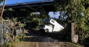 A motorhome is pictured off side of a flooded road 2018 near a house where nine people of the same family died after a small river burst its banks in Casteldaccia near Palermo. Photograph: Getty Images