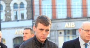 Calvin Cullen with a address at Greenhills, Athy on crutches at Naas District Court where he was charged with the murder of David Boland . Photograph: Garrett White/Collins Photo Agency