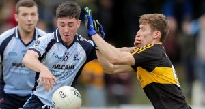 Moyle Rovers' Dara Ryan is put under pressure by Gavin White of Dr Crokes. Photograph: Laszlo Geczo/Inpho