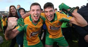 Corofin's Dylan Wall and Jason Leonard celebrate after they beat Mountbellew/Moylough to win the Galway SFC title. Photo: Lorraine O'Sullivan/Inpho