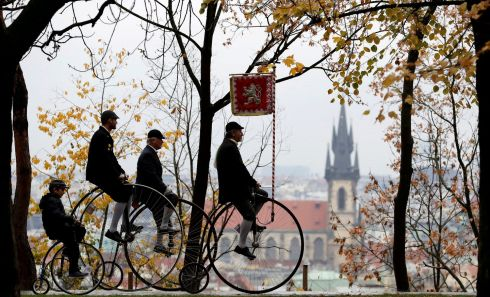RIDE 'EM HIGH: Race participants in suitably historical costumes ride their machines in an annual penny farthing bicycle race in Prague, Czech Republic. Photograph: David W Cerny/Reuters