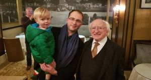 Myles Kelly (2), Maxim Kelly (38) and President Michael D Higgins at the homecoming in Galway on Sunday night.